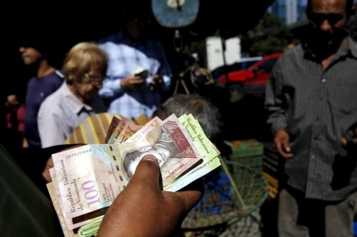 billete-100-economia-crisis-inflacion-devaluacion-reuters