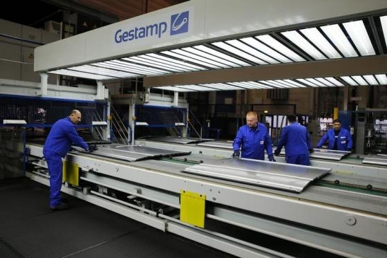 FILE PHOTO: Gestamp employees work in the Gestamp chassis innovation center in the western German city of Bielefeld